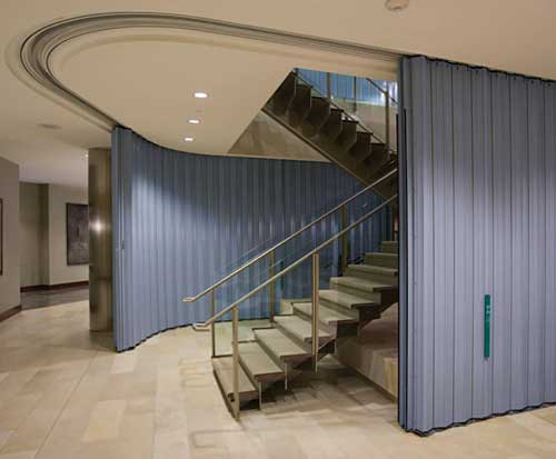 Curved Sliding Fire Doors Protect Multi Story Stairways And Eliminate The Need For Costly Smoke Removal Systems