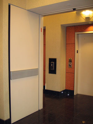 Section 707.14.1 of the 2006 IBC prescribes that design teams incorporate a fire-rated enclosed elevator lobby at the elevator shaft. & CE Center -