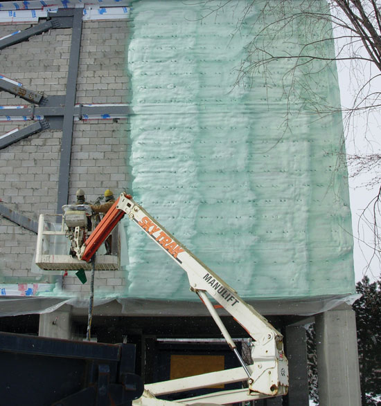 SPF Applied To The Exterior Of A Multistory Wall System Provides Complete  Continuous Insulation.