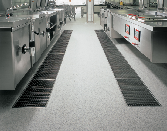 Stainless steel channels can be installed on most flooring types and work well in kitchens where there can be a high concentration of fats, chemicals, and high heat.