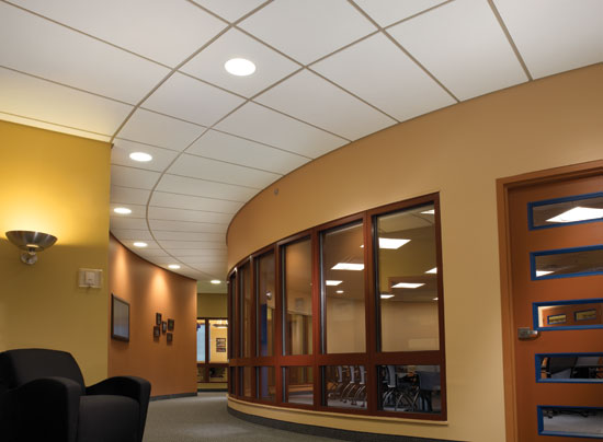 Traditional acoustic ceiling panels are available in more shapes and sizes, including shapes appropriate for ceilings radiating out from a circular center.