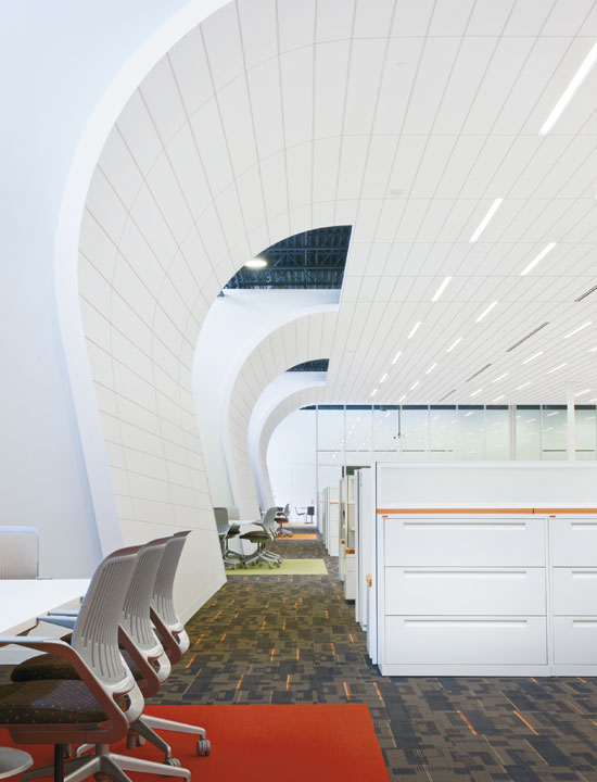 Extending the ceiling to become part of a wall system creates a visual and acoustical enclosure.
