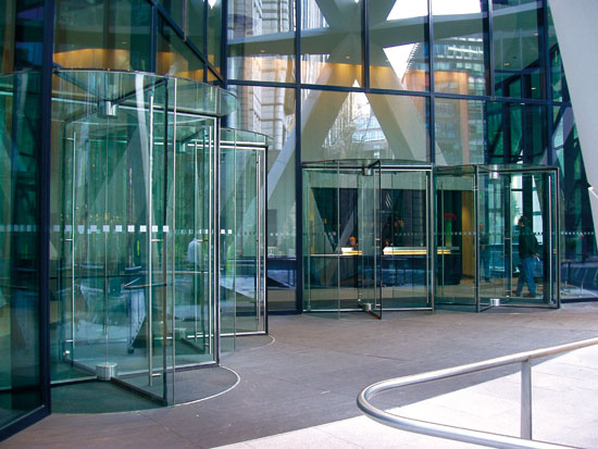 All-glass revolving doors are well-suited for a glass facade.