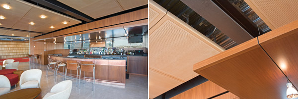 Acoustically treated wood ceiling  panels are used in this public area to balance sound absorption and reflection. Perforated panels contain acoustical material behind for high absorption while solid wood panels offer the right level of sound reflection.
