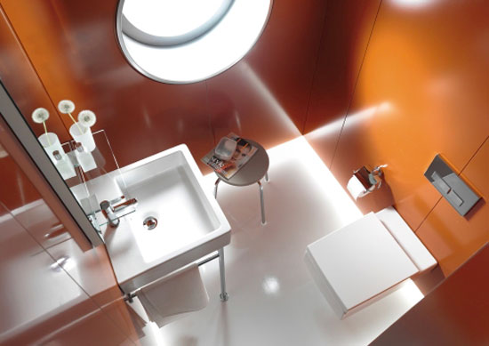A wall-mounted washbasin and toilet maximize space while maintaining aesthetic integrity.