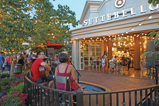 An outdoor stage and additional seating areas were created by the installation of an opening glass wall at Settebello Restaurant, Station Park, Farmington, Utah.