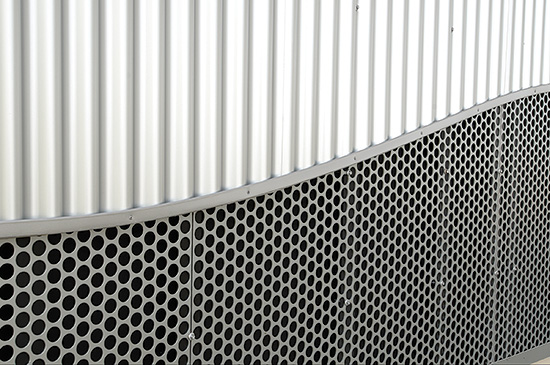 The Sunrise Mainline Toll Plaza was designed by RS&H of Orlando, Fla., to have a contrasting look between the silver metallic corrugated PAC-CLAD 7/8-in. panels and perforated metal wall material fabricated by Allied Architectural Metals, Inc.