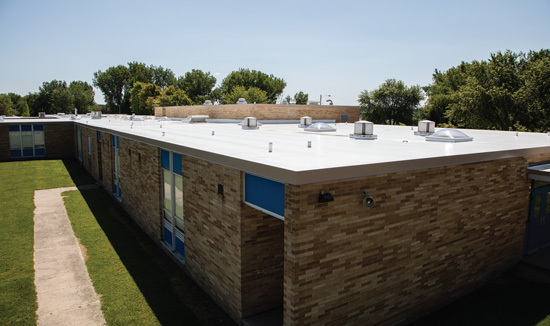 Studies show that cool roofing systems provide energy savings and other benefits when installed in cold climates. This cool roof was installed on West Shore Elementary School in Fenton, Michigan.