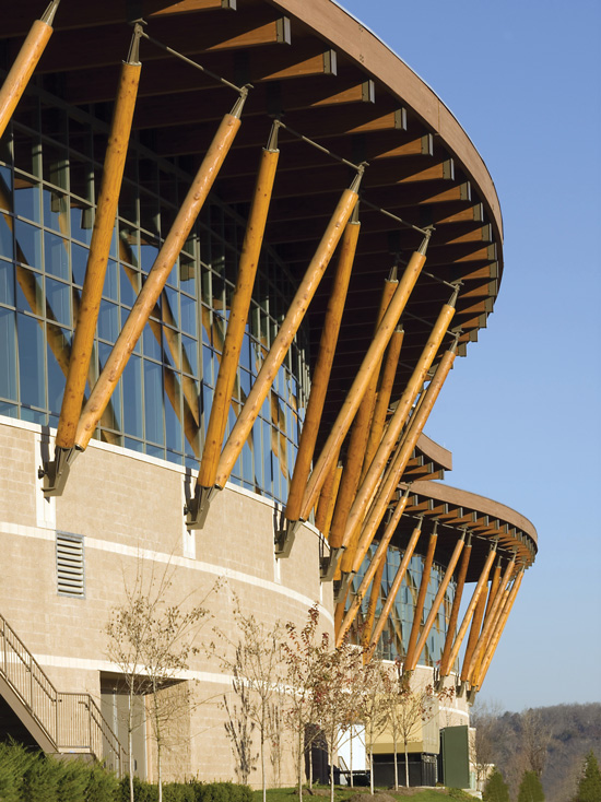 Designed by tvsdesign, the Branson Convention Center in Branson, Missouri, features a large overhanging roof. By sheltering the wood underneath, the roof deflects precipitation and helps to ensure long-term durability.