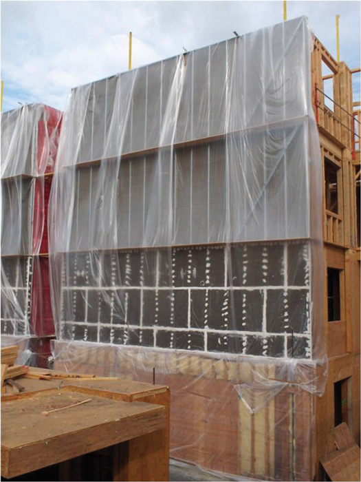 This photo shows how a multi-story wood building can be protected from 