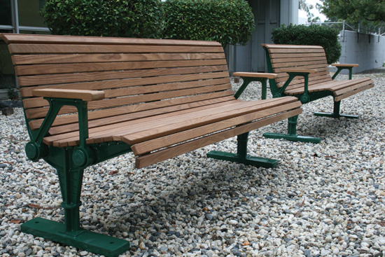 Thermally modified wood benches provide comfortable seating in high-use areas.