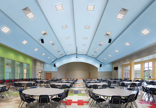 Perforations in metal ceilings provide acoustic benefits. Perforations vary in size according to aesthetic needs.