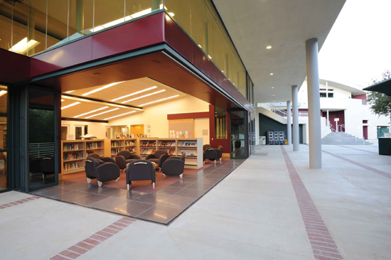 Folding glass doors connect interior spaces with the outdoors. At the Viewpoint School in Calabasas, California, Kalban Architects used a zero post corner system to completely open up the Fletcher Family Library to the courtyard when desired.