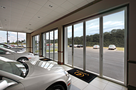 An all-aluminum folding glass door system gives Lexus dealership customers a feeling of being in a high-end home.