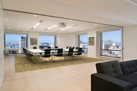 Aluminum glass folding doors provided flexibility that was key to the design of the public spaces at the Dutch Consulate in San Francisco.