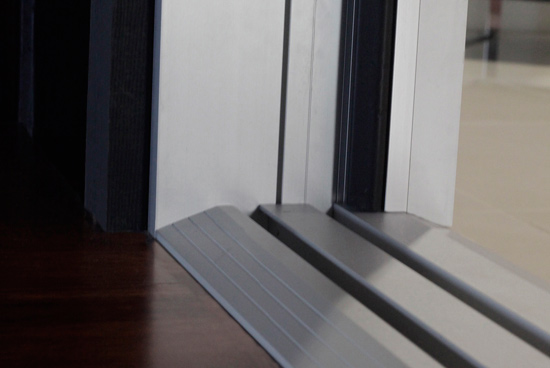Ce center folding glass doors are an asset for for Ada compliant flooring