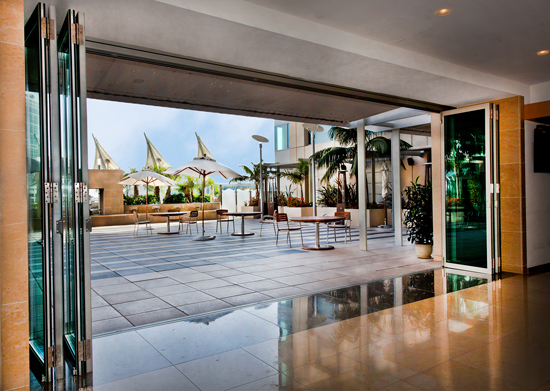 At the Omni Hotel, sleek aluminum framed folding glass doors bring the outside in, and create a feeling of luxurious spaciousness.