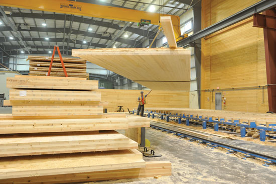 To manufacture CLT, several layers of kiln-dried lumber boards are stacked in alternating directions and bonded with structural adhesives to form solid, straight, rectangular panels.