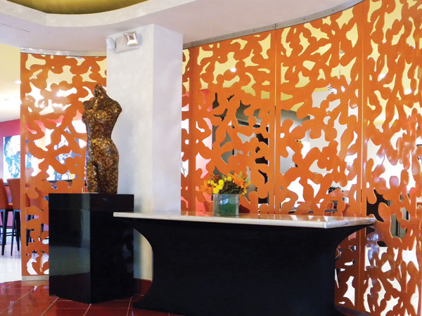 Use architectural panels with patterned openings to create stunning partitions, create shade, or camouflage unsightly equipment.