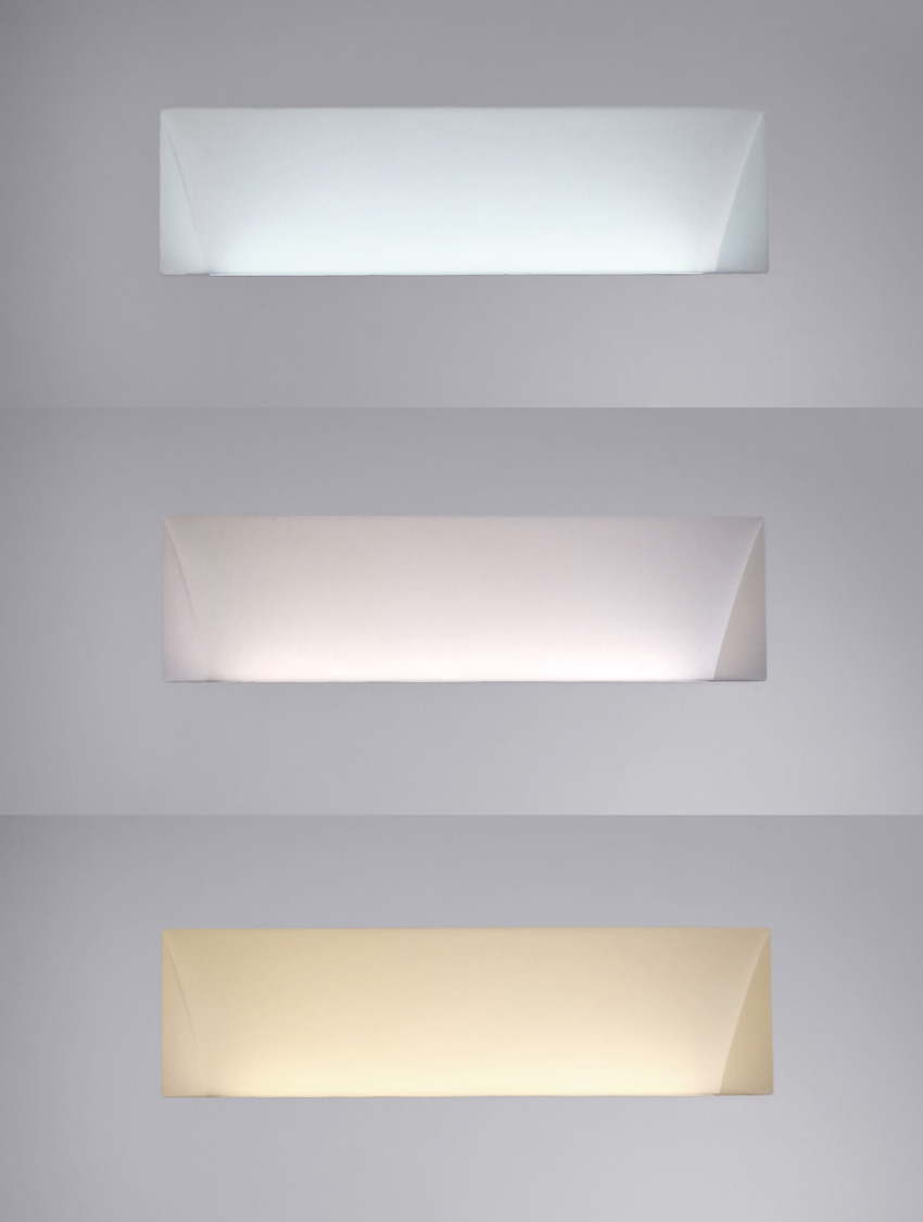 Photo of three wall-recessed, uplight luminaires.