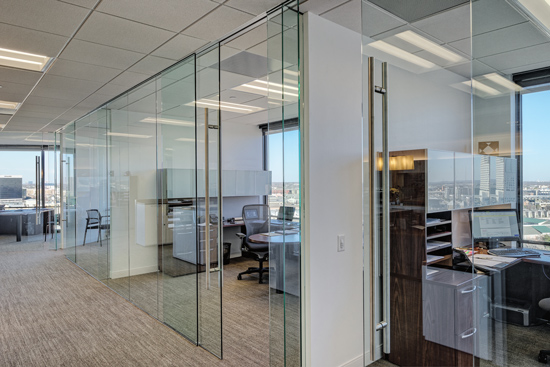 Sliding doors are a more space-effective solution than swinging doors because they require that less space be kept clear and unobstructed for the door to work properly.