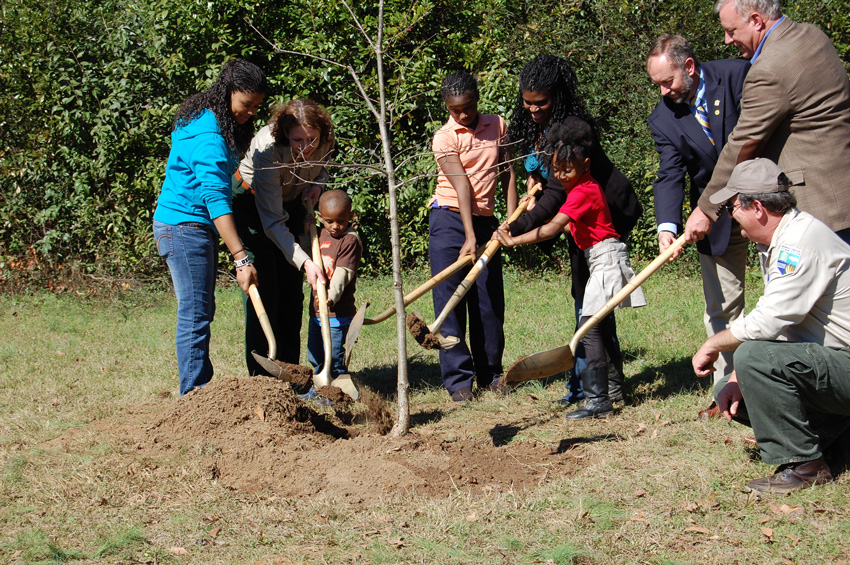 Photo of Jones family planting a tree.