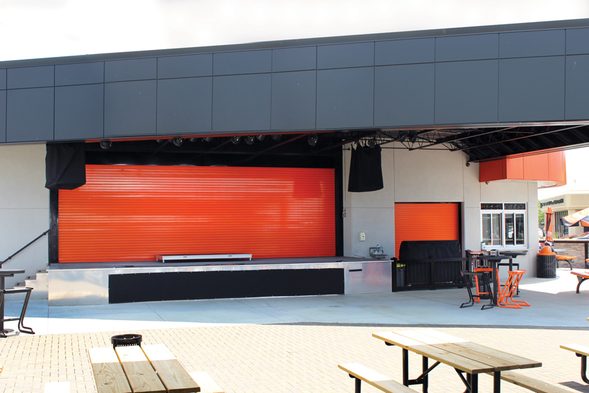 New durable rolling doors are meeting and exceeding energy codes, providing improved sound attenuation, and can be finished with attractive, no-VOC colors, as shown in the door for this new Harley Davidson distributor facility. The rolling steel doors protect the venue and equipment when not in use. The doors were powder coated with an orange that matches the brand's color guidelines.