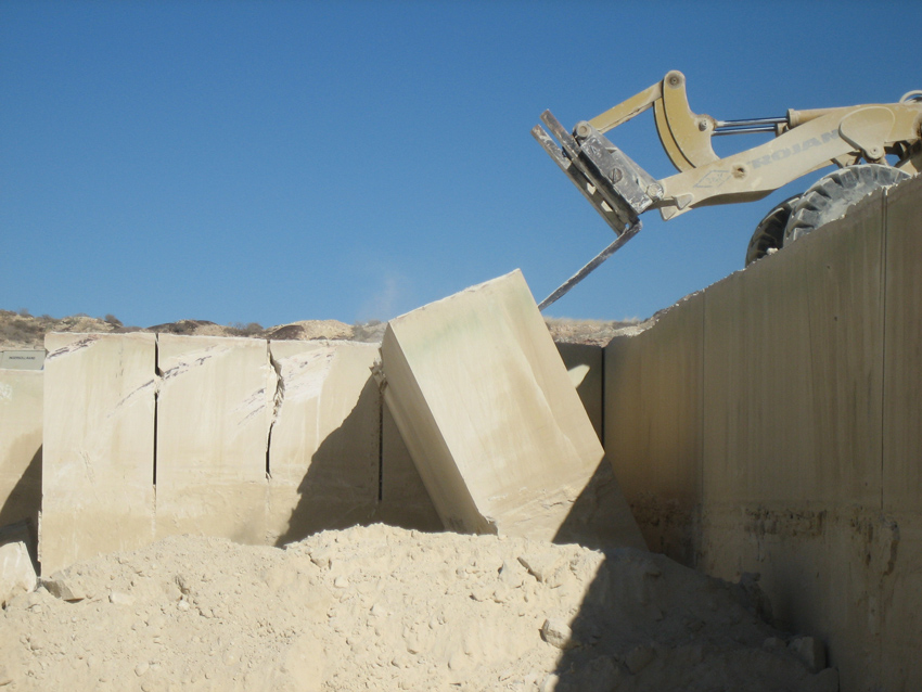 Quarry operations of limestone involve cutting large blocks and then tipping or leaning them onto their side to be carried to the mill.