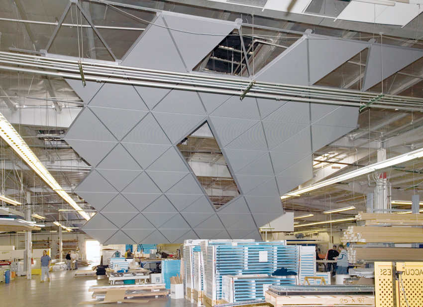 Photo of an acoustic ceiling system being assembled.