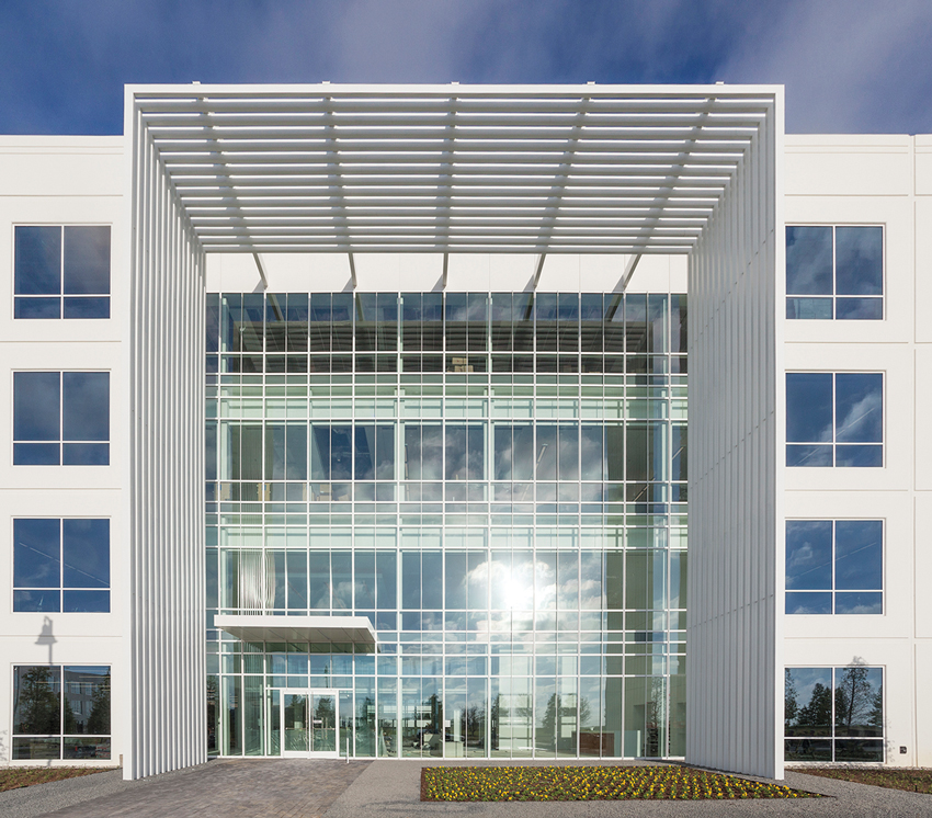 Photo of the 9001 Cypress Waters curtain wall.
