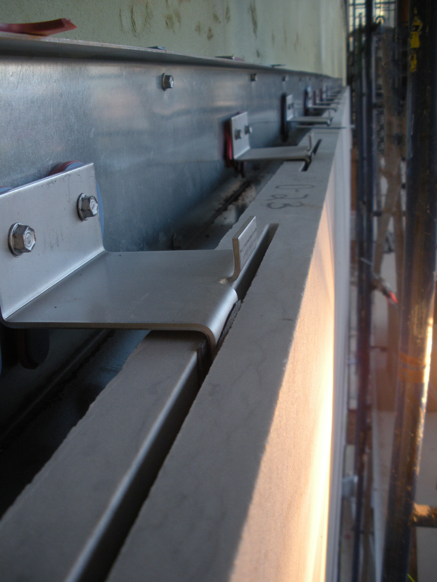 Pictured is an example of bent stainless steel shapes installed in stone cladding.