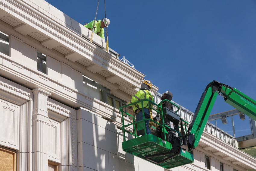 Photo of a stone facade during construction.