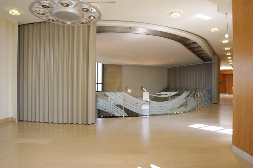 Photo of a curved sliding door for an interior stairway. & CE Center - Horizontal Sliding Fire Doors: Architectural Design Freedom