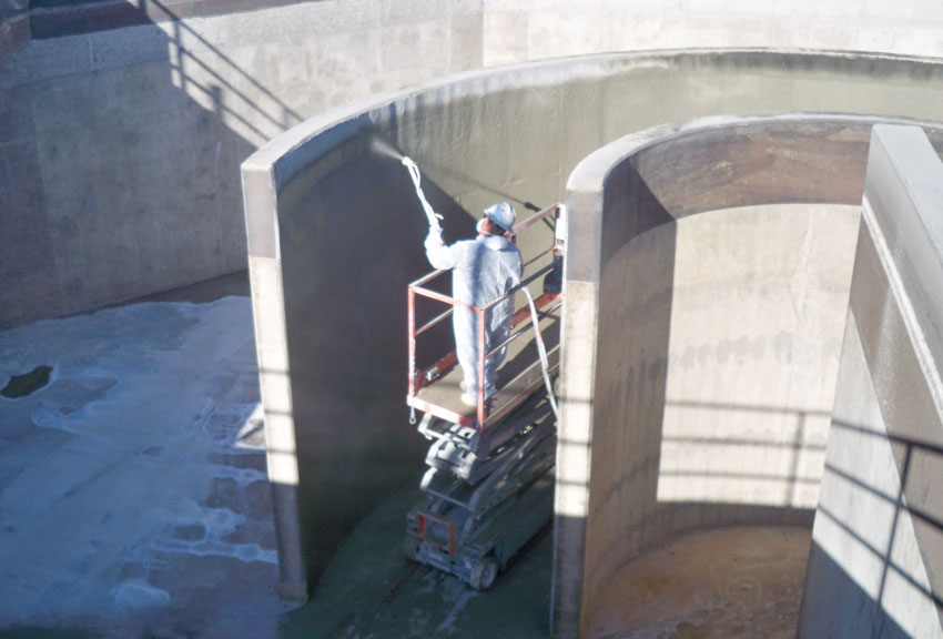 Photo of concrete construction being sprayed.