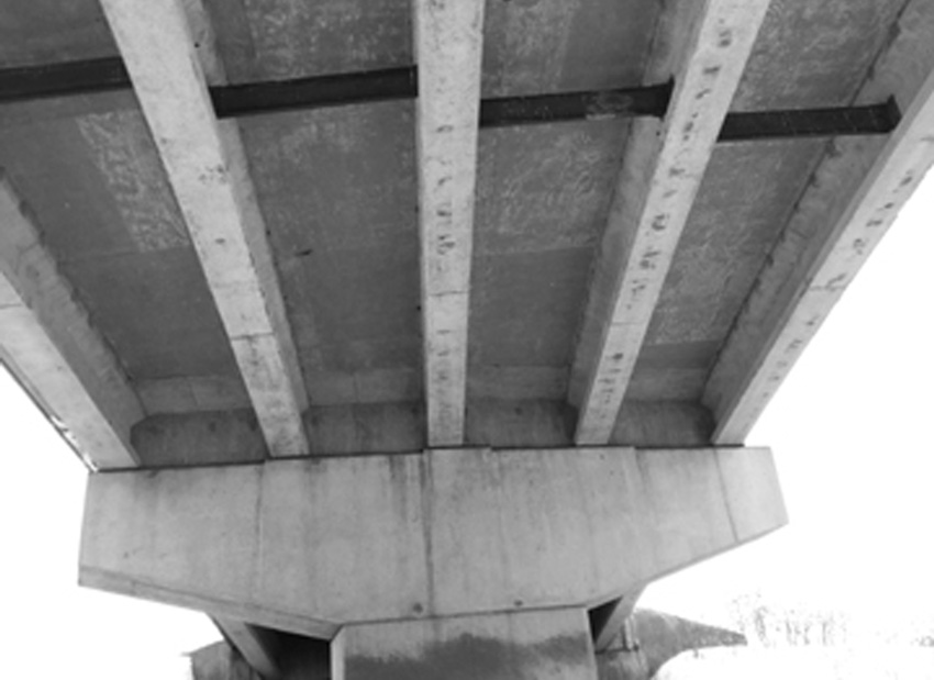 Photo of a concrete bridge support.