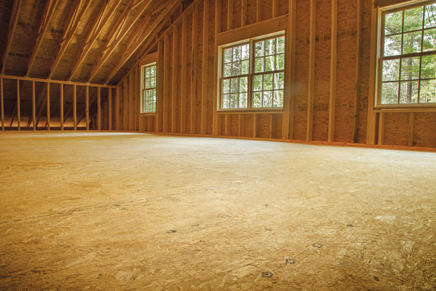 Photo of an interior under construction with wood floors.