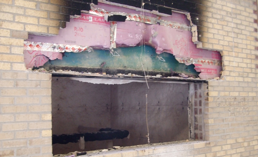 Figure 9:  Wall Showing Limited Fire Spread After Brick Veneer Has Been Stripped.