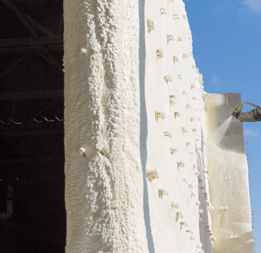 Photo of Low-permeability spray foam being applied.