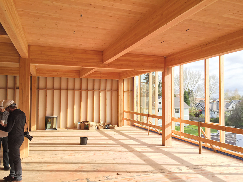 Photo of interior wood framing under construction.