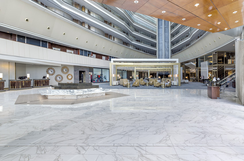 Photo of a lobby with a stone floor.