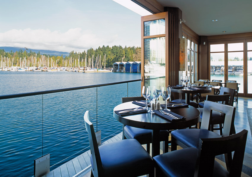 Photo of a restaurant on a waterfront.