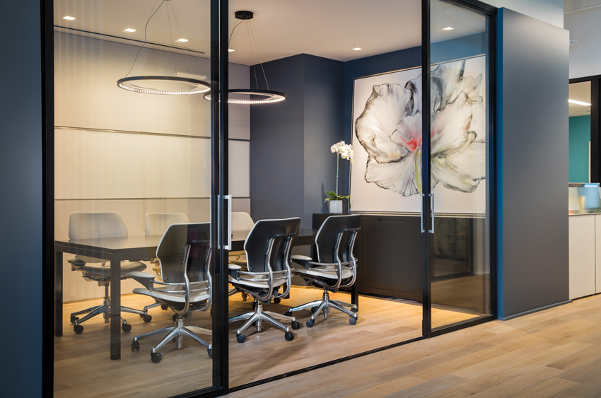Photo of a conference room with glass partition walls.