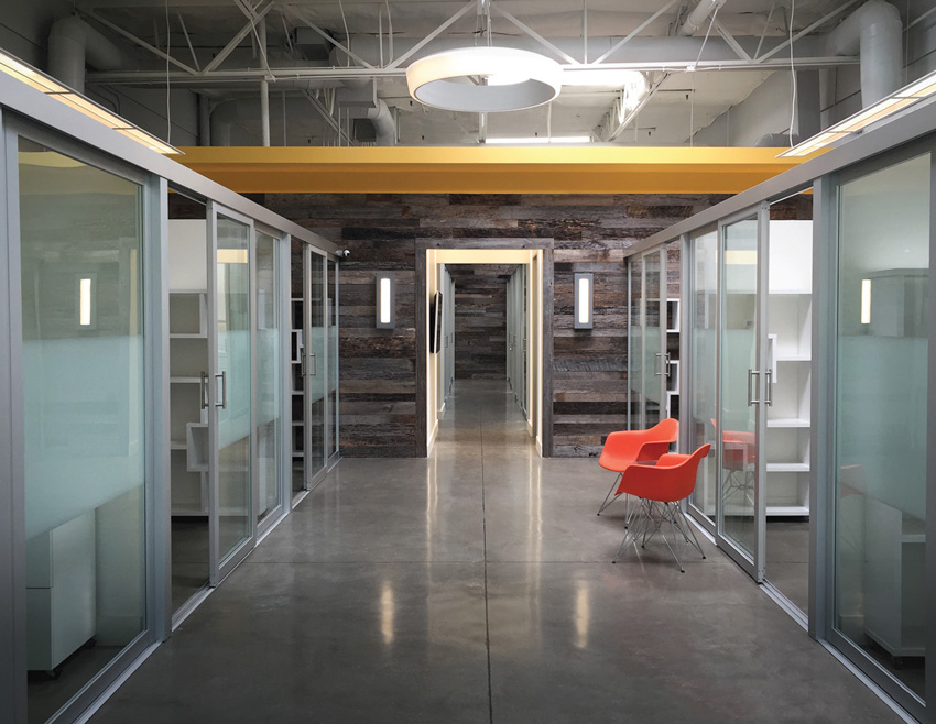 Photos of an office hallway with a walk-deck ceiling.