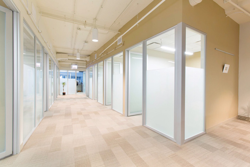 Photo of clinic's hallway with glass partitions.