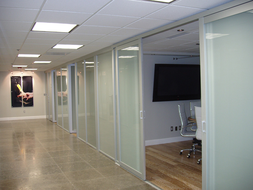 Photo of a hallway with sliding glass doors.