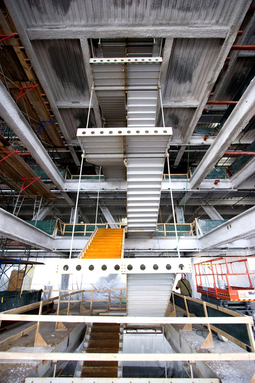 Pictured is the interior steel stairway hanging from the new construction above Blue Cross Blue Shield's vertical expansion.