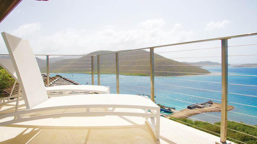A stainless steel cable railing system provides panoramic views from this outdoor deck.