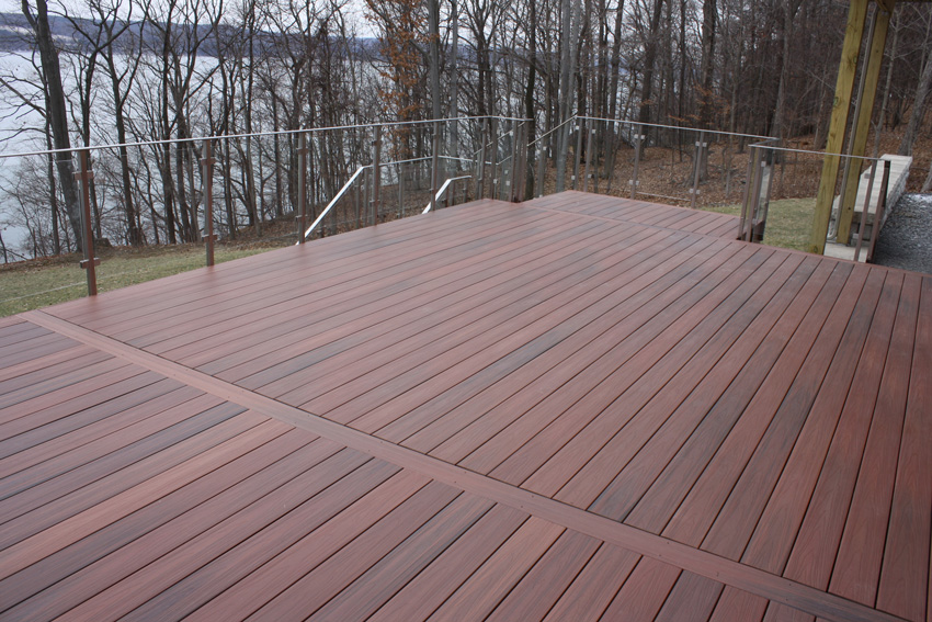 A side-mounted glass railing system extends the views from this deck in Lansing, New York.