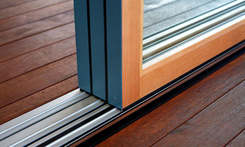 Stacking multi-slide panels stack flush when fully opened. Aluminum wood multi-slide system shown with flush sill.