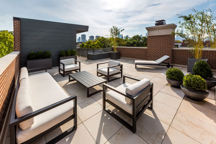 Natural stone is used as a roof deck walking surface at a private residence in Chicago.